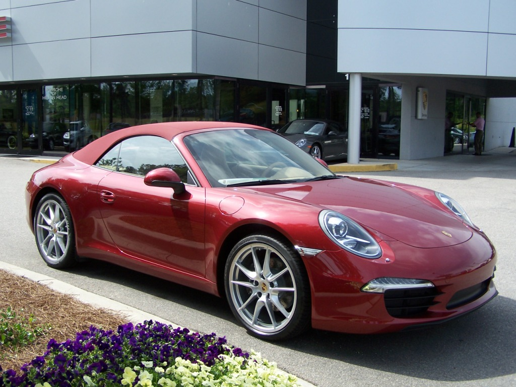 2012 Porsche 991 Carrera Cab in Ruby Red with a Red top and